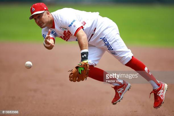 Rolando Acosta of Diablos Rojos throws the ball to first base during the match between Piratas de Campeche and Diablos Rojos as part of the Liga...