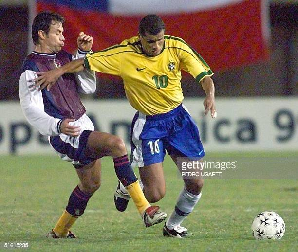 Rolando Alvarez of Venezuela and Rivaldo of Brazil fight for the ball during their Copa America match 30 June 1999 at the 03 February Stadium in...
