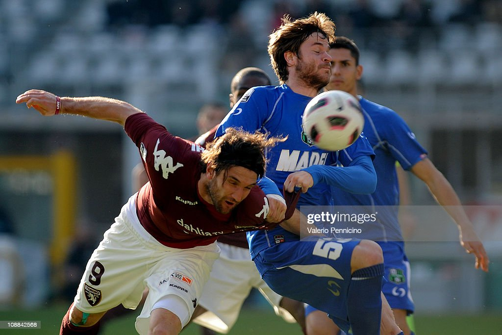 <a gi-track='captionPersonalityLinkClicked' href=/galleries/search?phrase=Rolando+Bianchi&family=editorial&specificpeople=605847 ng-click='$event.stopPropagation()'>Rolando Bianchi</a> of Torino FC clashes with <a gi-track='captionPersonalityLinkClicked' href=/galleries/search?phrase=Jonathan+Rossini&family=editorial&specificpeople=5780827 ng-click='$event.stopPropagation()'>Jonathan Rossini</a> of US Sassuolo Calcio during the Serie B match between Torino FC and US Sassuolo Calcio at Olimpico Stadium on February 5, 2011 in Turin, Italy.