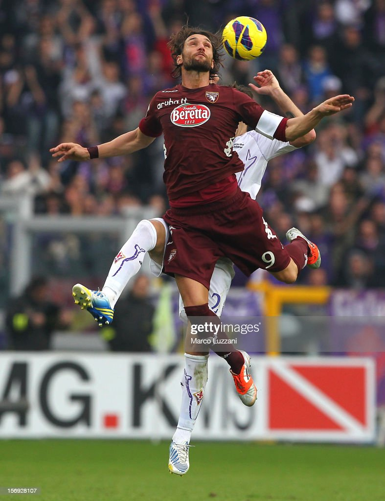 <a gi-track='captionPersonalityLinkClicked' href=/galleries/search?phrase=Rolando+Bianchi&family=editorial&specificpeople=605847 ng-click='$event.stopPropagation()'>Rolando Bianchi</a> of Torino FC competes for the ball with Gonzalo Rodriguez of ACF Fiorentina during the Serie A match between Torino FC and ACF Fiorentina at Stadio Olimpico di Torino on November 25, 2012 in Turin, Italy.