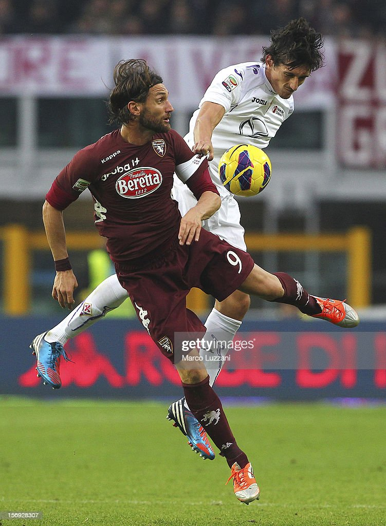 Rolando Bianchi of Torino FC competes for the ball with Stefan Savic of ACF Fiorentina during the Serie A match between Torino FC and ACF Fiorentina at Stadio Olimpico di Torino on November 25, 2012 in Turin, Italy.