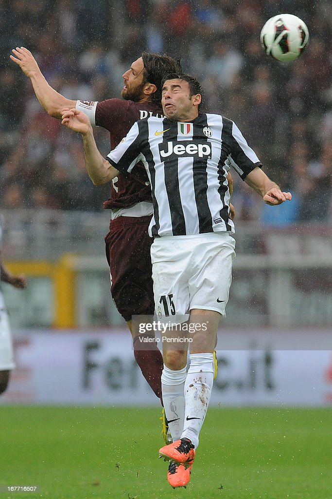 Rolando Bianchi (L) of Torino FC goes up with Andrea Barzagli of Juventus during the Serie A match between Torino FC and Juventus at Stadio Olimpico di Torino on April 28, 2013 in Turin, Italy.