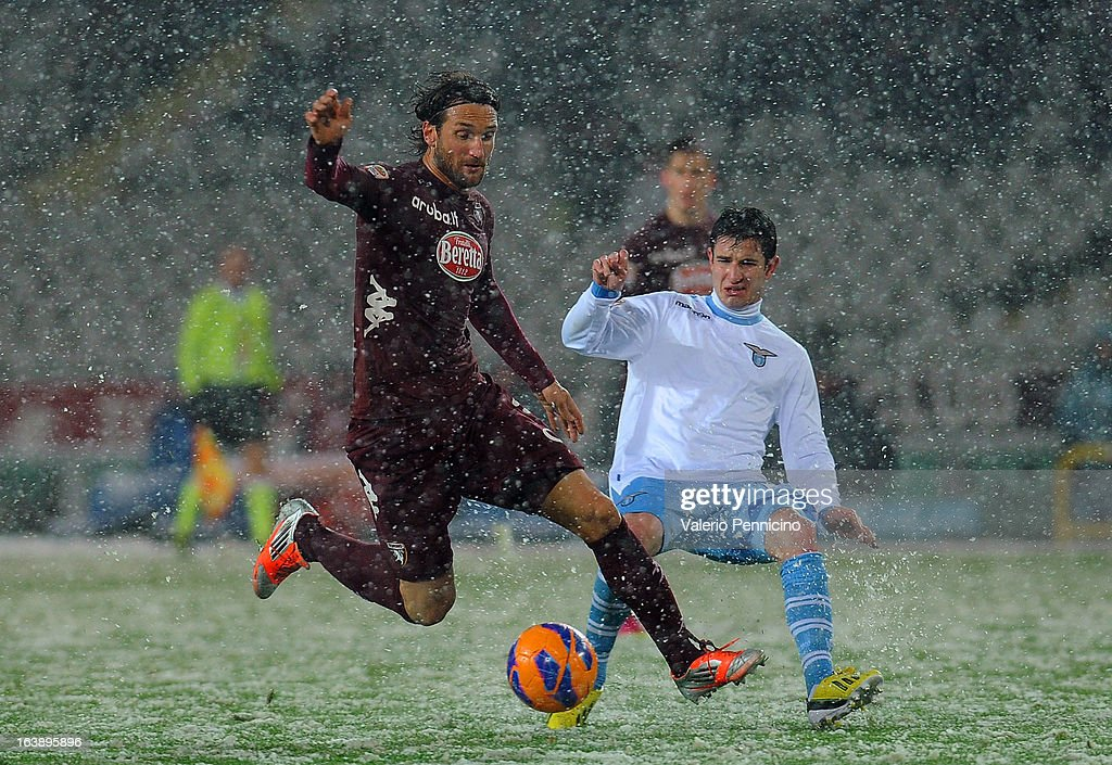 <a gi-track='captionPersonalityLinkClicked' href=/galleries/search?phrase=Rolando+Bianchi&family=editorial&specificpeople=605847 ng-click='$event.stopPropagation()'>Rolando Bianchi</a> (L) of Torino FC in action against Bruno Pereirinha of S.S. Lazio during the Serie A match between Torino FC and S.S. Lazio at Stadio Olimpico di Torino on March 17, 2013 in Turin, Italy.
