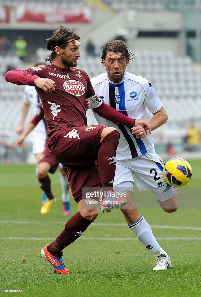 <a gi-track='captionPersonalityLinkClicked' href=/galleries/search?phrase=Rolando+Bianchi&family=editorial&specificpeople=605847 ng-click='$event.stopPropagation()'>Rolando Bianchi</a> (L) of Torino FC in action against Guglielmo Stendardo of Atalanta BC during the Serie A match between Torino FC and Atalanta BC at Stadio Olimpico di Torino on February 17, 2013 in Turin, Italy.