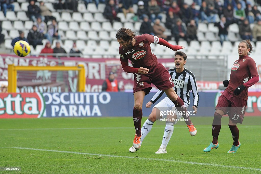 <a gi-track='captionPersonalityLinkClicked' href=/galleries/search?phrase=Rolando+Bianchi&family=editorial&specificpeople=605847 ng-click='$event.stopPropagation()'>Rolando Bianchi</a> of Torino FC scores their second goal during the Serie A match between Torino FC and AC Siena at Stadio Olimpico di Torino on January 13, 2013 in Turin, Italy.