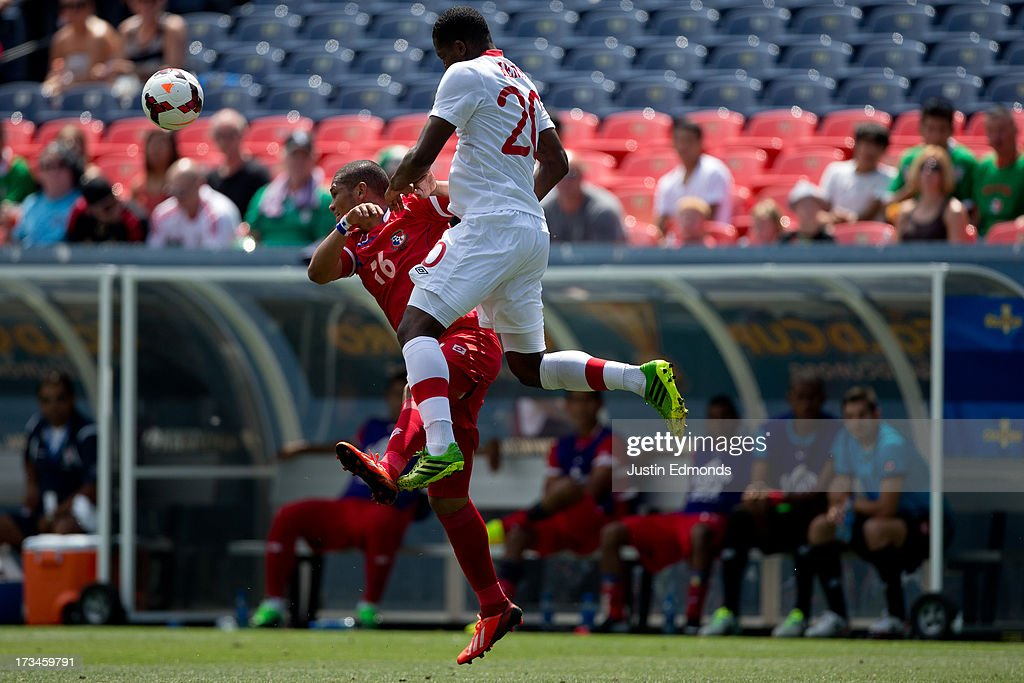 Rolando Blackburn #16 of Panama battles for a ball in the air with Doneil Henry #20 of Canada during the second half of a CONCACAF Gold Cup match at Sports Authority Field at Mile High on July 14, 2013 in Denver, Colorado. Canada and Panama played to a 0-0 draw.