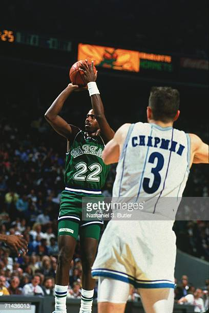 Rolando Blackmon of the Dallas Mavericks shoots a jump shot against Rex Chapman of the Charlotte Hornets during a game played in 1991 at the...