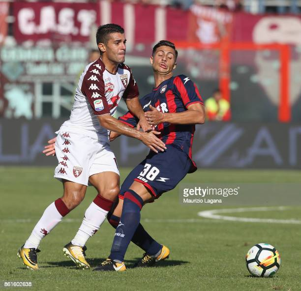 Rolando Mandragora of Crotone competes for the ball with Iago Falque of Torino during the Serie A match between FC Crotone and Torino FC at Stadio...