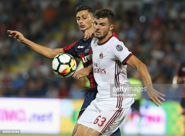 Rolando Mandragora of Crotone competes for the ball with Patrick Cutrone of Milan during the Serie A match between FC Crotone and AC Milan on August...