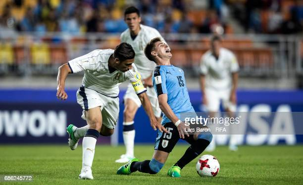 Rolando Mandragora of Italy challenges Facundo Waller of Uruguay during the FIFA U20 World Cup Korea Republic 2017 group D match between Italy and...