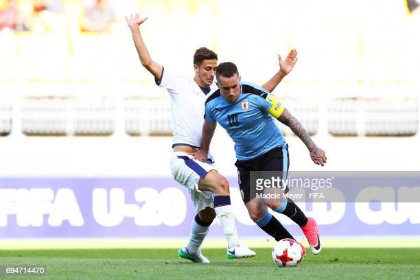Rolando Mandragora of Italy defends Rodrigo Amaral of Uruguay during the FIFA U20 World Cup Korea Republic 2017 3rd rank playoff match at Suwon World...