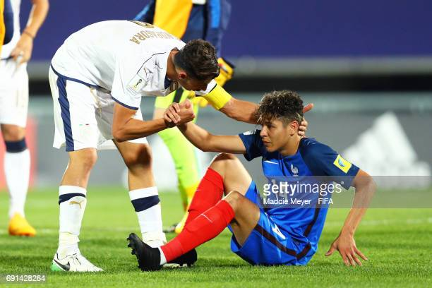 Rolando Mandragora of Italy helps up Amine Harit of France after Italy defeat France 21 in their FIFA U20 World Cup Korea Republic 2017 Round of 16...