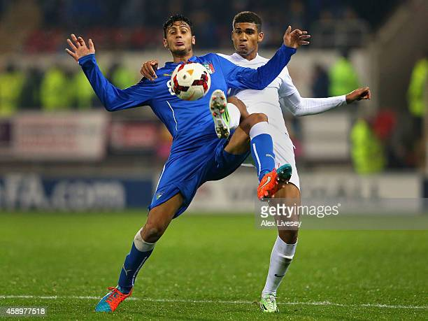 Rolando Mandragora of Italy U19 holds off a challenge from Ruben LoftusCheek of England U19 during the International friendly match between England...