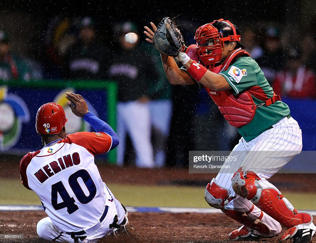 Rolando Marino #40 of Cuba scores as catcher Miguel Ojeda #35 of Mexico catches the late throw from left fielder Augustin Murillo during the 2009 World Baseball Classic Pool B match on March 12, 2009 at the Estadio Foro Sol in Mexico City, Mexico.