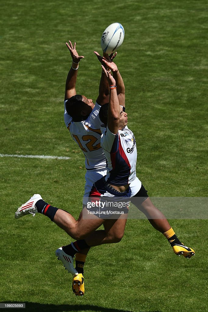 Rolani Lepupa (L) of Wellington and James Lowe of Tasman compete for the ball during the National Rugby Sevens at Queenstown Recreation Ground on January 12, 2013 in Queenstown, New Zealand.