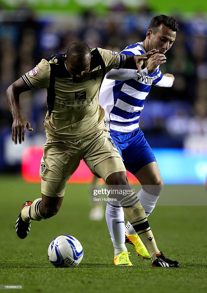 Roldolph Austin of Leeds holds off the challenge off Adam Le Fondre of Reading during the Sky Bet Championship match between Reading and Leeds United at Madejski Stadium on September 18, 2013 in Reading, England.