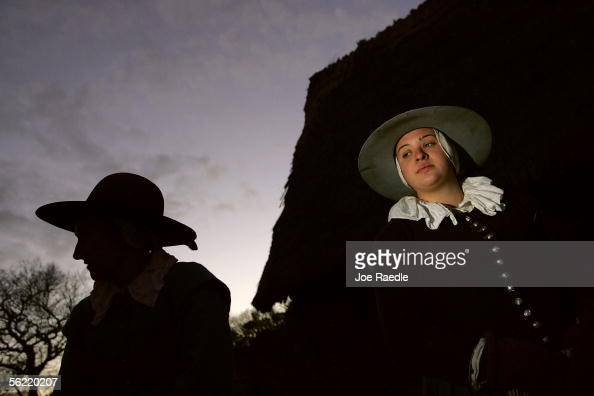 Roleplayers walk through the 1627 Pilgrim Village at 'Plimoth Plantation' where they portray Pilgrims seven years after the arrival of the Mayflower...