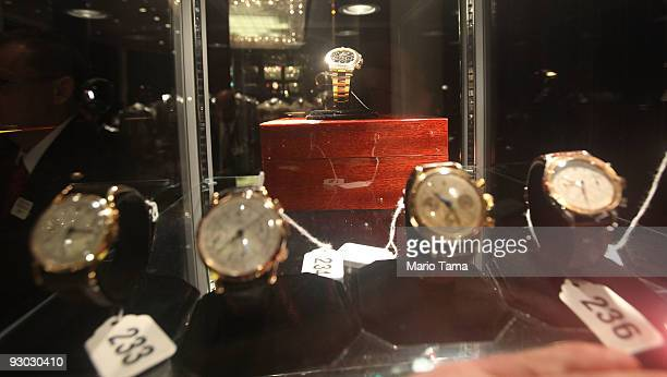 Rolex watches are displayed during a press preview of a US Marhals Service auction of personal property seized from Bernard and Ruth Madoff November...