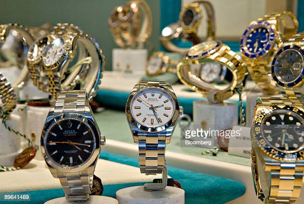 Rolex wristwatches sit on display in the window of a store in New York US on Monday July 6 2009 Consumers are coping with the recession by spending...