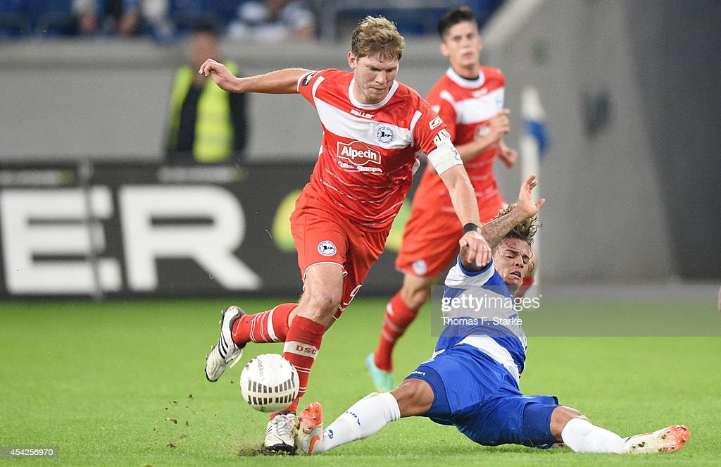 Rolf Feltscher (R) of Duisburg tackles Fabian Klos of Bielefeld during the Third League match between MSV Duisburg and Arminia Bielefeld at Schauinsland-Reisen-Arena on August 27, 2014 in Duisburg, Germany.