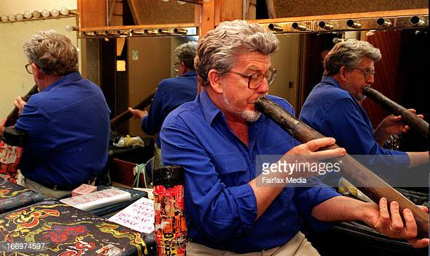 Rolf Harris plays the didgeridoo before performing at the St George Leagues Club in Sydney April 30 1996
