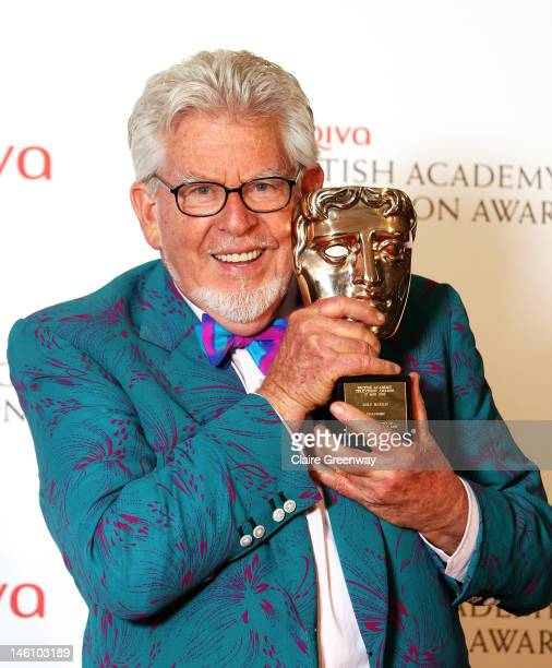 Rolf Harris poses with the Fellowship Award in front of the winners boards at The Arqiva British Academy Television Awards 2012 at The Royal Festival...