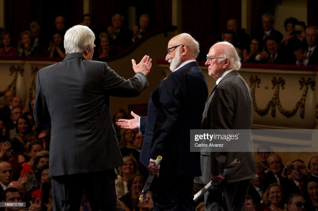 Rolf Heuer, Francois Englert and Peter Higgs receive the Prince of Asturias Award for Technical & Scientific Research during the 'Prince of Asturias Awards 2013' ceremony at the Campoamor Theater on October 25, 2013 in Oviedo, Spain.
