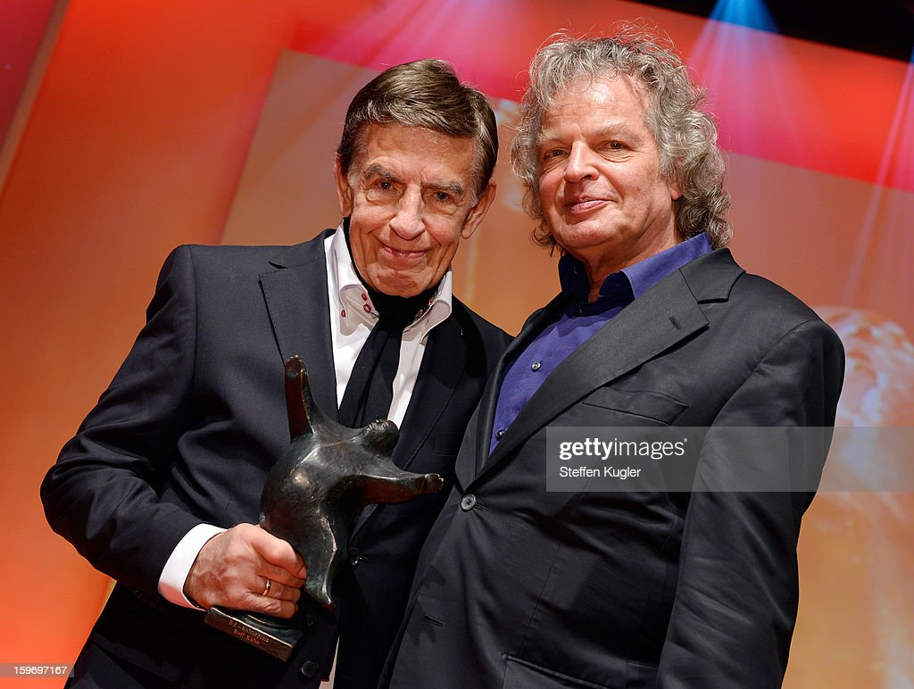 Rolf Kuehn (L) poses with his award and his brother Joachim Kuehn after the show at the B.Z. Kulturpreis on January 18, 2013 in Berlin, Germany.