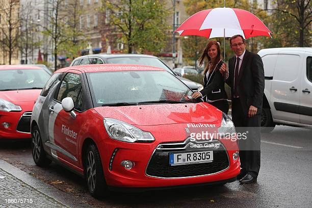 Rolf Luebke Chairman of Deutsche Bahn Mobility Networks Logistics which owns carsharing provider Flinkster poses with Elena Eybe Flinkster's 250000th...