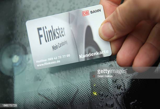 Rolf Luebke Chairman of Deutsche Bahn Mobility Networks Logistics which owns carsharing provider Flinkster demonstrates the use of a customer account...