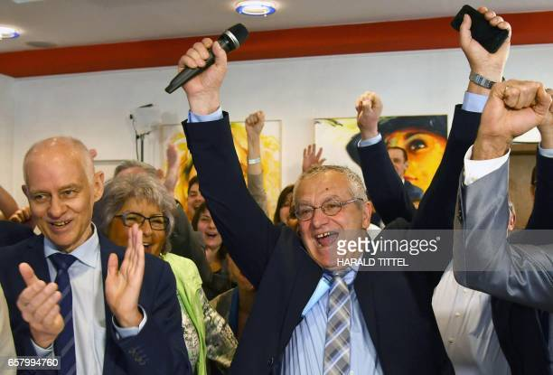 Rudolf Mueller top candidate of the Alternative for Germany for the state election in Saarland reacts after exit poll results of the state election...
