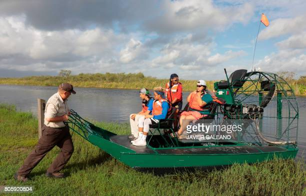 Rolf Olson US Fish Wildlife Service officer pushes an airboat before an airboat tour with a Soul River youth group at the Arthur R Marshall...