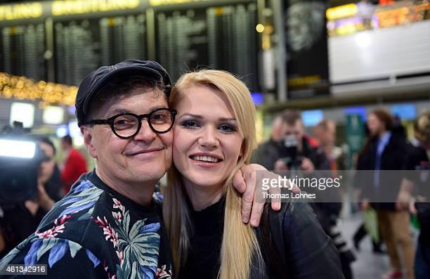 Rolf Scheider and Sarah Kulka pose before the flight to Australia as a participants in the 2015 RTLTVShow 'Dschungelcamp Ich bin ein Star Holt mich...
