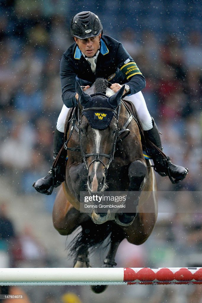 Rolf-Goeran Bengtsson of Sweden and his horse Casall la Silla compete in the Mercedes-Benz Price team jumping competition during day three of the 2012 CHIO Aachen tournament on July 5, 2012 in Aachen, Germany.