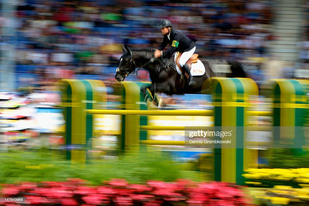 Rolf-Goeran Bengtsson of Sweden ans his horse Carusso LS La Silla compete in the RWE Prize of North-Rhine-Westphalia jumping competition during day four of the 2012 CHIO Aachen tournament on July 6, 2012 in Aachen, Germany.