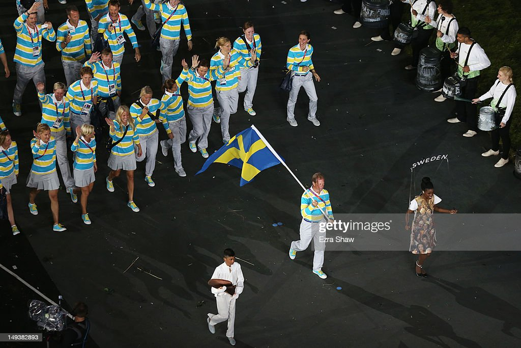 Rolf-Goran Bengtsson of the Sweden Olympic equestrian team carries his country's flag during the Opening Ceremony of the London 2012 Olympic Games at the Olympic Stadium on July 27, 2012 in London, England.