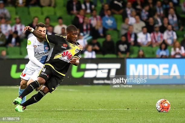 Rolieny Bonevacia of the Phoenix compete for the ball against Ben Garuccio of Melbourne City during the round 25 ALeague match between Melbourne City...
