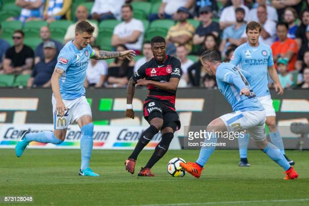 Rolieny Bonevacia of the Western Sydney Wanderers Ross McCormack of Melbourne City and Michael Jakobsen of Melbourne City contest the ball during...
