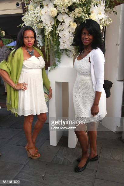 Rolise Rachel and Michelle Travis attend the B Floral Cocktail Hour at the Southampton Social Club on August 17 2017 in Southampton New York