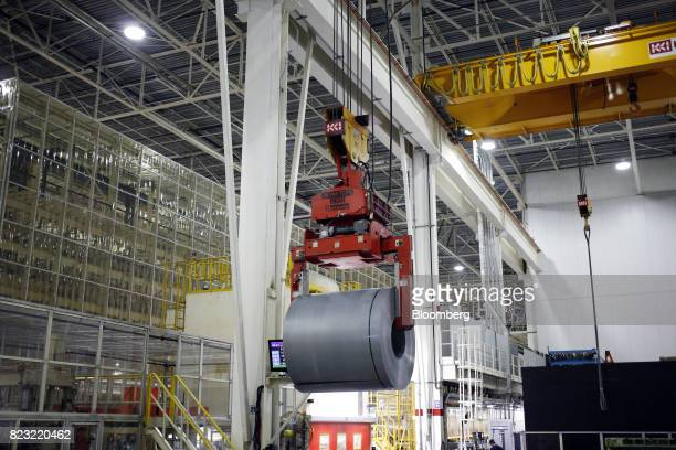 A roll of aluminum hangs from a crane in the stamping plant at the Hyundai Motor Manufacturing Alabama facility in Montgomery Alabama US on Wednesday...