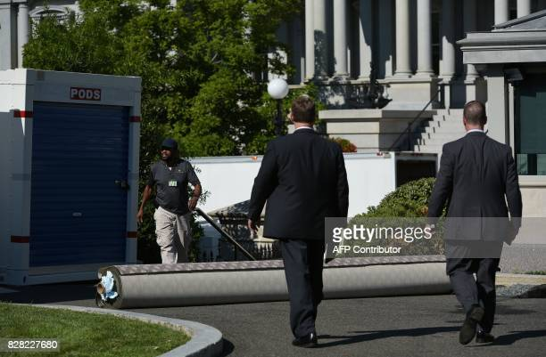 A roll of carpet is seen outside of the West Wing of the White House as it undergoes renovations on August 9 2017 in Washington DC / AFP PHOTO /...