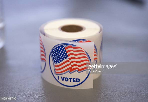 A roll of 'I Voted' stickers which are handed out to residents after they vote sit on an election officials table at a polling place on November 4...