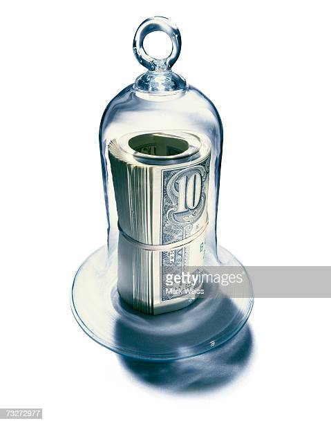Roll of notes under bell jar