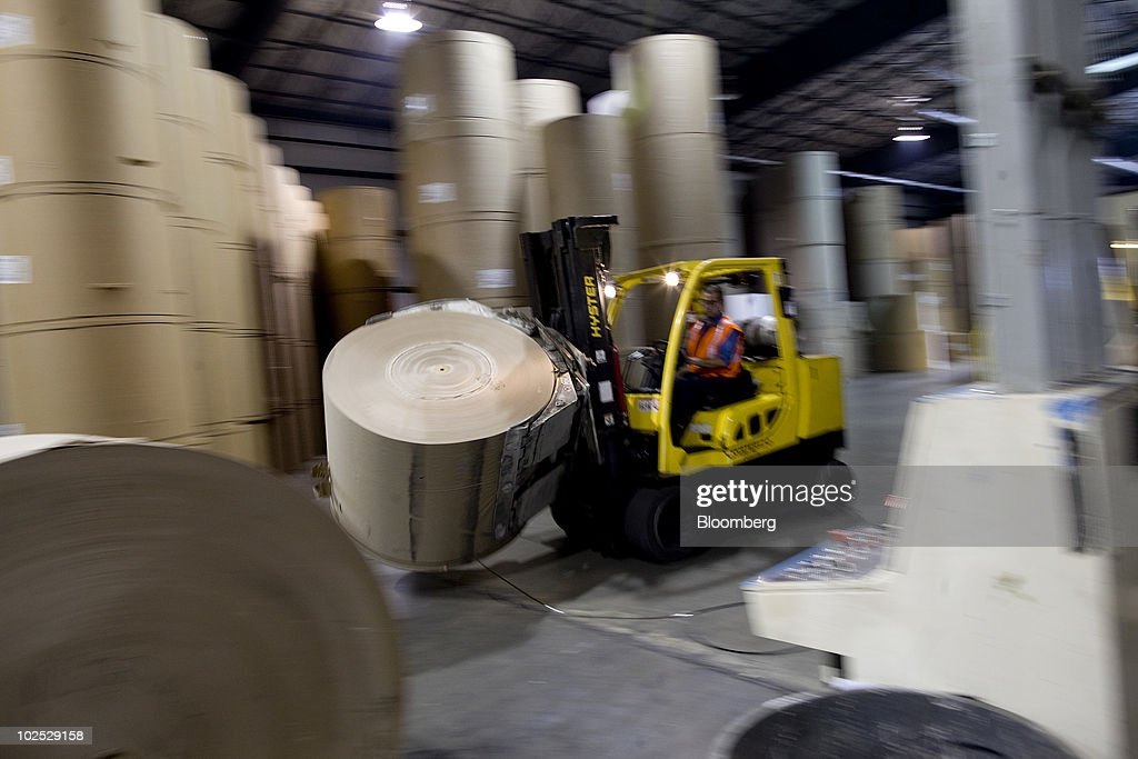 A roll of recycled paper is moved by a forklift at the Pratt Industries USA Inc paper recycling and corrugated box manufacturing facility in the...