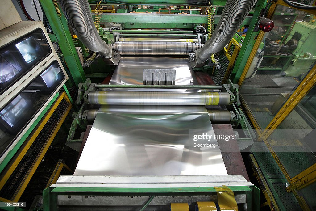 A roll of sheet aluminum passes through a slittering machine at the Novelis Inc. production facility in Yeongju, South Korea, on Thursday, May 23, 2013. Novelis plans to boost research and development staff by 40 percent as the biggest supplier of flat-rolled aluminum products to global carmakers seeks to increase recycled content in products used in cans and vehicles. Photographer: Woohae Cho/Bloomberg via Getty Images