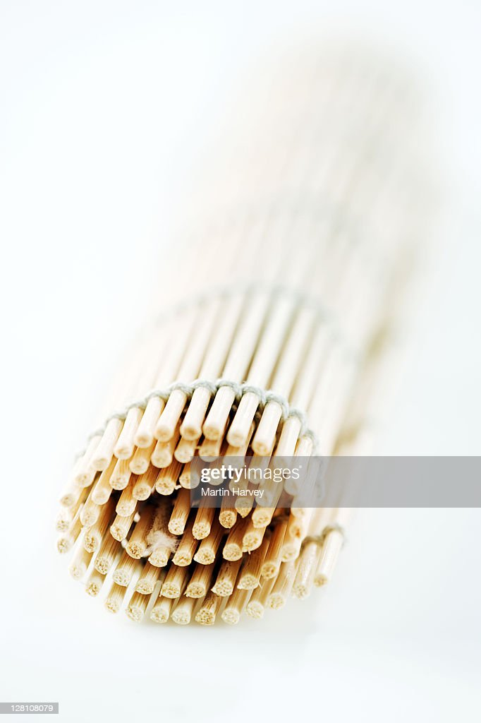 Rolled bamboo mat against white background. : Stock Photo