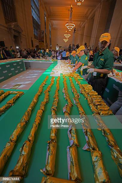 Rolled hot dogs lined up to form part of '100' for Nathan's Famous centennial Led by Nathan's Famous George Shea 2016 Hotdog Eating Champion Joey...