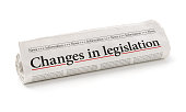 Rolled newspaper with the headline Changes in legislation