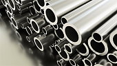 Rolled round metal industrial shiny tubes background, 3d rendering of metallic objects, shaped tubes with shining