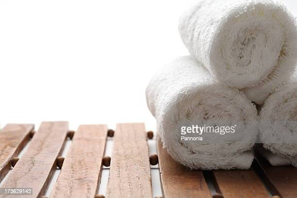 Rolled up bath towels on a decorative frame